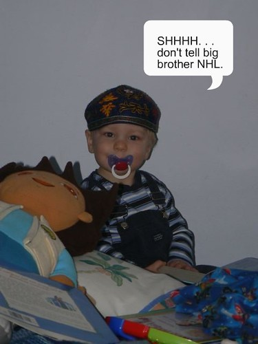 Hanging out in big brother's bed with his kippah