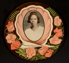 African American woman and sweet peas (George Eastman House) Tags: 1920s portrait woman black medallion africanamerican oval georgeeastmanhouse geh:maker=unidentifiedphotographer geh:accession=200805030006 geh:medium=gelatinsilverprintandchromolithographmountedoncelluloidmedallion