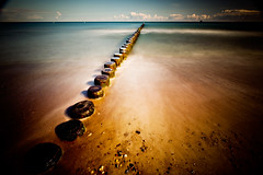 Buhnen (96dpi) Tags: wood longexposure sea bw beach clouds strand warnemünde meer wolken baltic erosion holz groyne ostsee rostock buhne küstenschutz hydraulicstructure