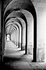Calling (Dave G Kelly) Tags: uk england blackandwhite bw architecture canon manchester 350d vanishingpoint arch britain arches repetition gb canoneos350d sigma2470mm freetradehall manchesterthroughmyeyespotd