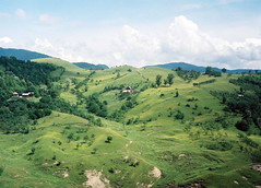 Shades of Green (Iulian Dumitru) Tags: house green film grass clouds rural forest 35mm village hill romania idyllic jupiter8 zorki6