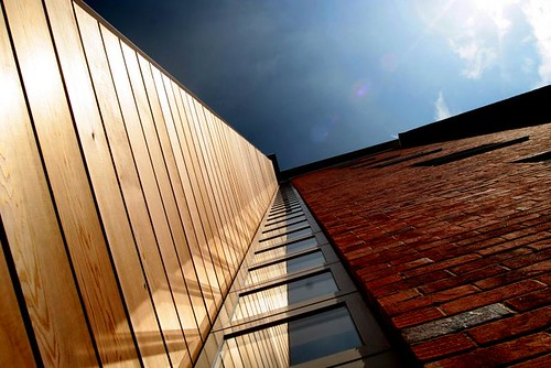 Glass, wood, brick, sky and lens flare