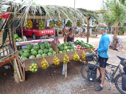 Road side fruit vendor. 1 small watermelon = 0.40 USD.