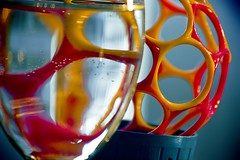 squishy (Ashley Dale) Tags: pink orange abstract reflection ball colorful neon ambientlight wineglass macrolens hotpick