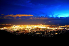 City Lights or Lava Flow? (Tom Herlyck) Tags: city sunset newmexico clouds albuquerque sandiamountains sandiapeaktramway