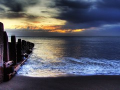 Sunrise Over Hornsea HDR (Osgoldcross Photography) Tags: wood morning shadow sea sun reflection rot wet clouds early sand shiny waves decay sandy shoreline east shore breakers groyne hdr atmospheric eastcoast eastyorkshire hornsea woodrot sunsrise humberside 3xp photomatix handheldhdr