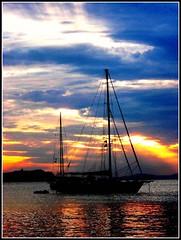 Sailing in Paradise, Sunset in Mykonos, Greece (moonjazz) Tags: travel sunset sea sky nature clouds greek harbor still paradise sailing ship quiet peace aegean tourist calm adventure explore greece harmony mast bliss mediterrean supershot
