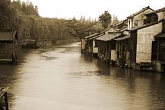 Wu Zhen, China (J K Johnson) Tags: china old trip travel water monochrome beautiful rain docks buildings river dark boat canal wooden interesting moody rainy traveling wuzhen dank chineese jimjohnson tranqual jkjohnson