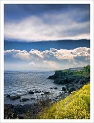 nuvole sulla scogliera (Andrea Rapisarda) Tags: blue sea naturaleza nature colors yellow clouds geotagged rocks nuvole mare vivid natura sicily sicilia scogli e510 acicastello anawesomeshot olympuse510 theperfectphotographer vosplusbellesphotos andrearapisardaolympus geo:lat=37542814 geo:lon=1513989