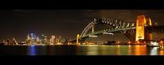 sydney skyline pano clich fest (mugley) Tags: sky autostitch panorama water skyline architecture modern night clouds digital buildings reflections prime lights nikon pano sydney australia nsw newsouthwales coathanger nikkor dslr stitched touristshot urbanlandscape sydneyoperahouse sydneyharbourbridge d300 sydneycove 50mmf14d dontknowwhattheyrecalled 24xp fiddymil heapsoftallbuildings dontexactlygiveastuff kenduncanwankfest frommilsonspt gettyreject