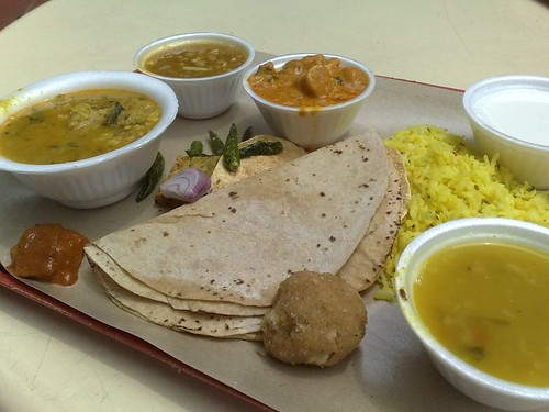 Clockwise from left: dhal bati, some little noodle-like thing, gatta, rice, dhal, laddu, chapati