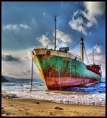 Drifting Ship at Ras Hlal ! (Bashar Shglila) Tags: world sea sky beach clouds photoshop photography photo al amazing gallery ship photos top group best most worlds popular libya shipwrecks ras hdr lybia drifting jabal akhdar photogroup the libia   libyen photomatix   lbia hlal  libi darnah libiya  liviya libija   assafa dernah     lbija  lby libja lbya liiba livi