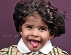 Funny Portrait (Talal Al-Mtn) Tags: pink girl canon studio kid crazy funny child shot protrait kuwait q8 450d canon450d alshai5a almtn talalalmtn  kidsprotrait