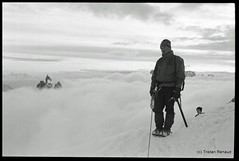 Mount Blanc du Tacul and a sea of clouds (__Tristan__) Tags: sea bw mountain france monochrome clouds 35mm nikon rope mountaineering fm2 crampons aiguilledumidi tacul massifdumontblanc ropedparty