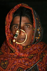 Asia - India / Jat woman, a tribe in Gujarat (RURO photography) Tags: voyage travel portrait woman india tourism beautiful smile face female scarf canon fun photography mujer asia asien pretty faces photos retrato femme muslim islam mulher cara reis tourist piercing portraiture asie nosering lonelyplanet frau portret indi islamic gujarat inde nationalgeographic reizen discoverychannel azi hoofddoek nosepiercing moslim bhuj jat gesichter supershot jath kartpostal enstantane anawesomeshot hodka voyageursdumonde journalistchronicles globalbackpackers discoveryphoto discoveryexpeditions rudiroels neusring thegalleryoffineportrait dhanetajat inspiredelite jatpeople jatwoman jathpeople jathwoman