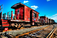 Red Caboose (Surrealize) Tags: seattle wood blue red sky window yellow metal clouds train graffiti nikon rust rocks industrial cone steel tracks rail railway caboose westseattle handheld remotecontrol shipyard washingtonstate shipping harborisland hdr gravel 9exp d700 surrealize