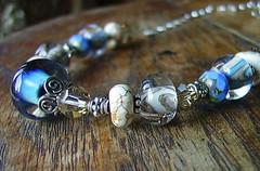 sand and sky (aka maire dodd) Tags: blue sky beach glass necklace sand tan chain clear lampwork magnesite sandandsky