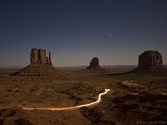 Moonlight Mitten (Dave Arnold Photo) Tags: pictures nightphotography arizona usa southwest west monument night canon utah us photo ut desert image photos arnold picture az pic images photograph western getty sw monumentvalley mesa breathtaking mittens streaminglight ariz swusa startrail westernusa westmitten davearnold perfectpicture eastmitten greatimage canonequipment peaceaward heartawards breathtakinggoldaward grouptripod platinumpeaceaward yourwonderland davearnoldphoto davearnoldphotocom mygearandmegold mygearandmeplatinum arnoldd