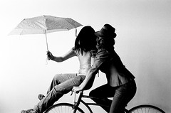 black rain (gguillaumee) Tags: girls shadow party people bw film smile bike brooklyn contrast umbrella pose photo fuji sunday rainy shooting neopan bushwick 1600iso