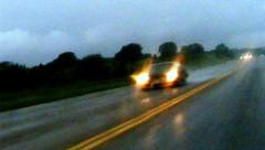 Rainy Day Drive, Headlights Thru Windshield (danagraves) Tags: texture reflections movement blurry saturated lighttrails cloudysky yellowlines postprocessing throughwindow threecars gettingdark rainfalling