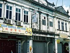 (Dani Irwan) Tags: film weird rangefinder streetscene 35mmfilm malaysia electro gt decrepit yashica shophouses streetshot bicycleshop expiredfilm oldshops yashicaelectro semenyih yashicaelectrogt yashicaelectro35gt expiredkodakgold100 yashinon45mmf17dx filmjunkiesunite