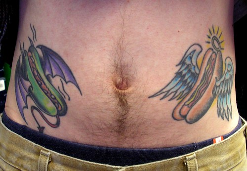 Jeff's good and evil hot dog tattoos guide his life.
