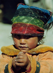 in a shadow:::::by druidworld (druidworld) Tags: world street school nepal boy portrait black color colour cute girl beautiful smile face children photo kid nice eyes pretty gallery child skin little head eating album small innocent working young picture handsome shy cap kathmandu hungry theface