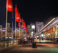 Moving Moving World (Harlz_) Tags: city longexposure motion night canon lights sydney australia blurred nsw darlingharbour monorail 1020mm pyrmontbridge eos50d