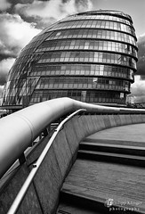 Following The Handrail (Philipp Klinger Photography) Tags: city uk greatbritain windows sky bw white black reflection london tower window glass thames architecture modern clouds facade river hall blackwhite nikon triangle europe unitedkingdom cityhall walk hill perspective victoria queen normanfoster gb philipp queenswalk sirnormanfoster klinger thequeenswalk d700 sigma50mmf14 dcdead