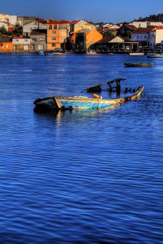 Barca abandonada. Abandoned boat.
