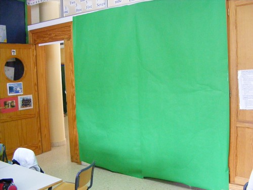 A Green Screen made from wide bright green poster paper for classroom displays