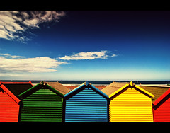 Beach Huts (Paul M. Robinson) Tags: blue red sea summer sky holiday colour green beach yellow coast seaside sand nikon d70 yorkshire tokina huts whitby 1224