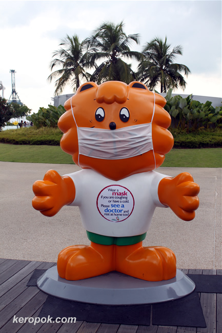 Singa the Courtesy Lion wears a mask