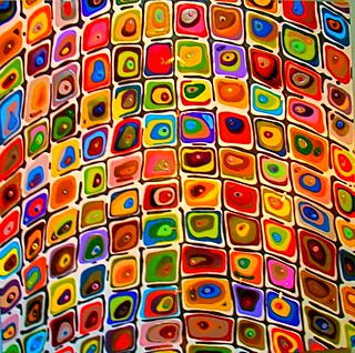 77 unique squares of art on a wall
