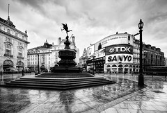 It rained... (Philipp Klinger Photography) Tags: street uk england sky bw sculpture white house black reflection building london window wet lamp rain statue architecture clouds stairs facade reflections blackwhite nikon europe angle britain circus united great ad wide steps picadilly kingdom eros gb sanyo sw lcd philipp weiss sigma1224mm schwarz tdk klinger aplusphoto ultimateshot d700 dcdead