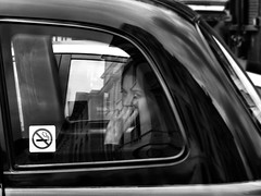 Ever wonder? (ro_nya) Tags: urban bw london traffic streetphotography wondering blackcab londonist ronya ronyagalka