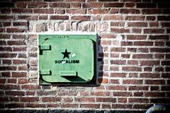 Socialism? (FreakyLeo) Tags: street door city brick green wall göteborg star sweden political gothenburg wing sverige hatch left socialism canon5dmarkii powmerantusenord canonef135mm2lusm