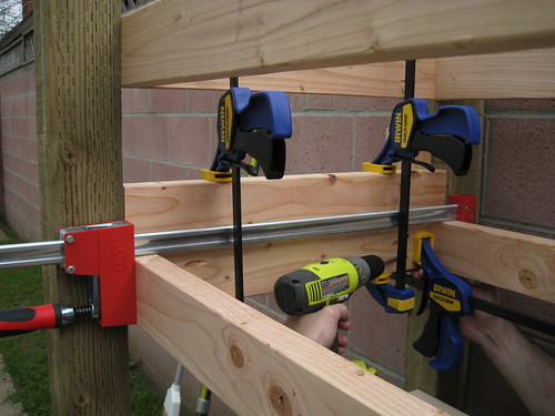 clamps and pocket holes join the short beams for the second rack section