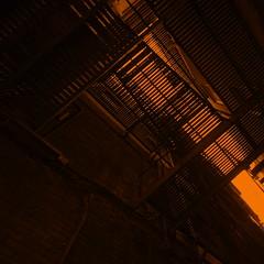 orange slices (eflon) Tags: orange brick monochrome metal alley diagonal burnt fireescape narrow