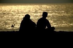 Morning togetherness !!! (The Umbrella Man!!) Tags: india beach canon chennai bipin canoneos400d bipinbabu tiruvammyur thiruvamyur thiruvamyurbeach