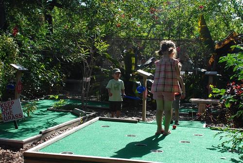 kids playing mini golf