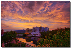 Fire in the Sky (Fraggle Red) Tags: sunset cloud yellow canal florida balcony handheld jpeg hdr aventura canonefs1022mmf3545usm 3exp miamidadeco dphdr villagebythebay theviewlookingwest