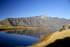 Deerfield Heights Lake (pusspaw) Tags: blue newzealand sky brown lake mountains reflection beautiful grass lotr southisland queenstown lordoftherings theremarkables 3waychallenge deerfieldheights