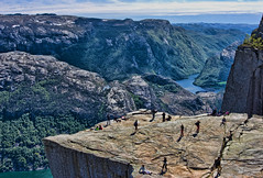 Pulpit Rock and Beyond (Jim Boud) Tags: ocean sky cliff mountain norway clouds digital canon eos rebel hike atlantic valley fjord xsi topaz preikestolen prekestolen lysefjorden norse adjust pulpitrock 450d forsand jimboud jrbxom jamesboud jamesboudphotoart gettyvacation2010
