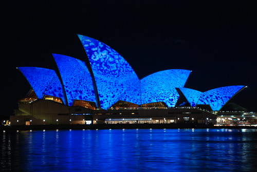 Blue opera and relectoins shades on the water sydney opera house australia