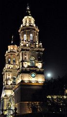 Moon about to enter the church (Armando Maynez) Tags: voyage travel vacation moon church night noche nikon morelia cathedral religion catedral luna traveling nikkor armando michoacan 18200 vacaciones 18200vr challengeyouwinner cywinner myfacebook maynez