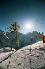 Drag lift (Ed.ward) Tags: sky holiday snow france mountains alps film wheel drag skiing lift superia pylon poles expired chamonix 2009 nikonf80 expiredfilm fujisuperia draglift skiier fb:uploaded=true fb:request=true nikkor20mmf28afd iphone:request=true