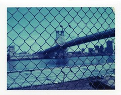 williamsburg bridge + plastic cup (instant satisfaction) Tags: nyc newyorkcity newyork cup brooklyn fence polaroid manhattan 360 f16 williamsburg expired williamsburgbridge plasticcup expiredfilm eastriverpark iduv expired072007 manual360 modified360