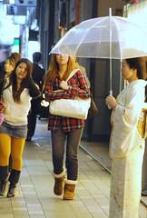 Ginza contrasts (Enigma911) Tags: girls woman japan contrast walking tokyo ginza nikon april 日本 東京 銀座 kimono 2009 着物 傘 d300 夜 женщина девушка вечер nikkohotel nikkor18200 зонт ホステス кимоно японка dentsustreet гинза 電通通り 日光ホテル