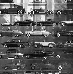 * (BckWht) Tags: seattle street 6x6 rolleiflex mediumformat washington fullframe windowdisplay kodaktmax400 35e antiquecars xenotar autaut epsonv500scanner whatsthatsmartcardoingupontop